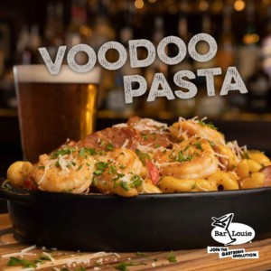 Bowl of Bar Louie Voodoo pasta with a beer